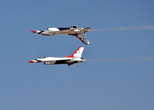 White Black and Red Jet at Daytime