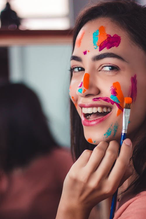 Woman With Blue and Red Face Paint