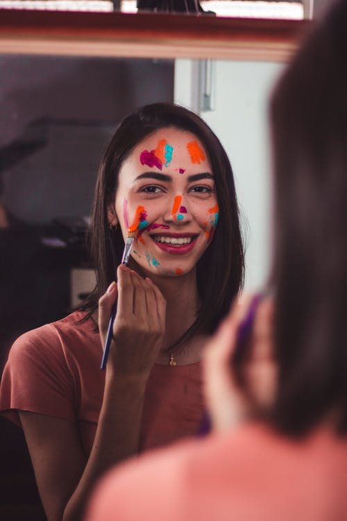 Woman in Brown Shirt With Face Paint