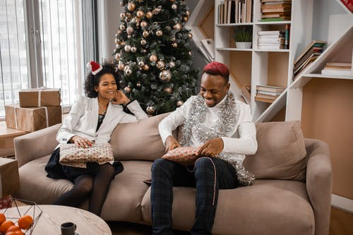 African American People Holding Gifts