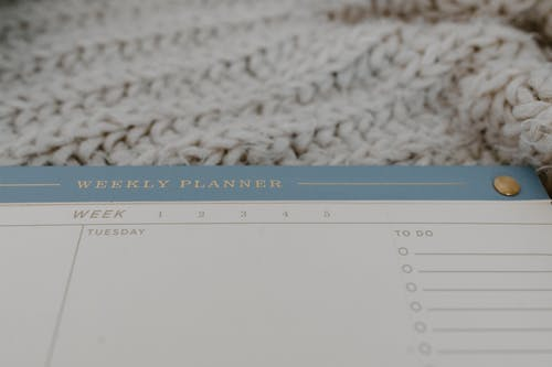 Close Up Shot Of Weekly Planner