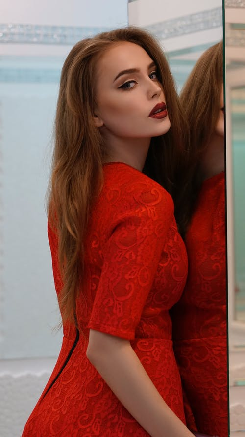 Woman in Red Long Sleeve Shirt