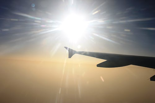 Free stock photo of aeroplane, aeroplane window, aircraft wing, sun