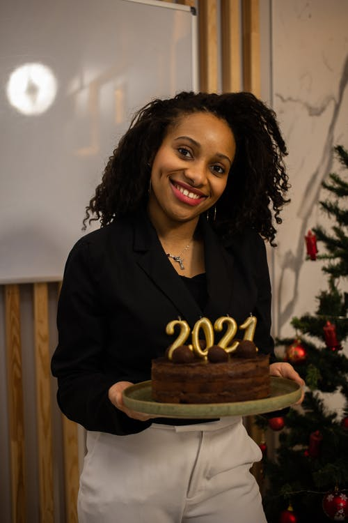 African American Woman Holding A Cake