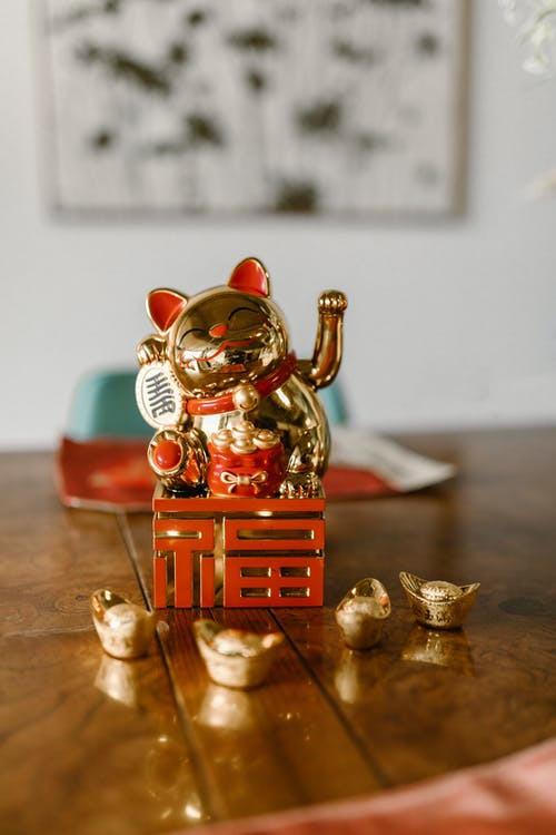Red and Gold Ceramic Dog Figurine
