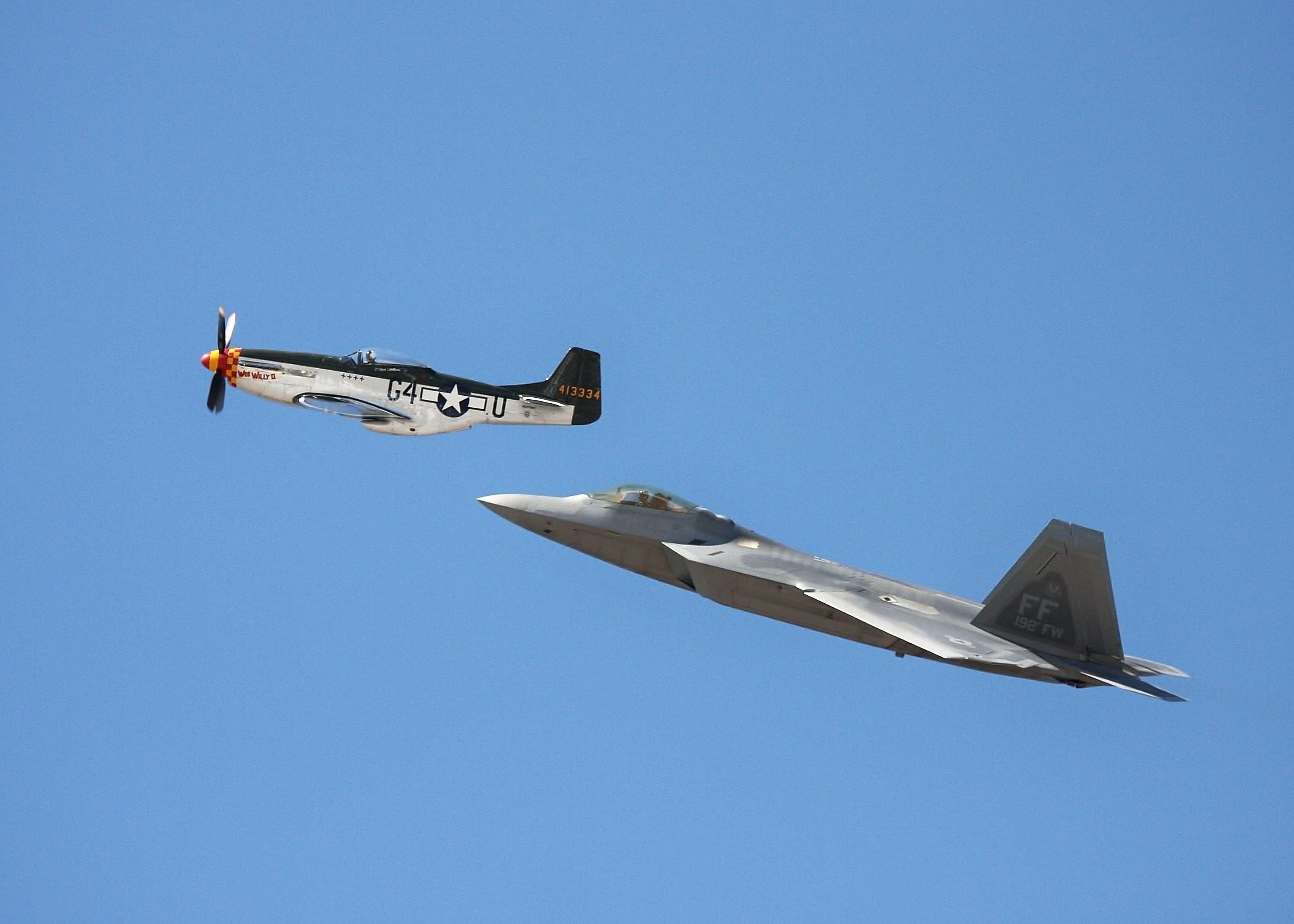 2 Jet Planes Flying Under Blue Sky