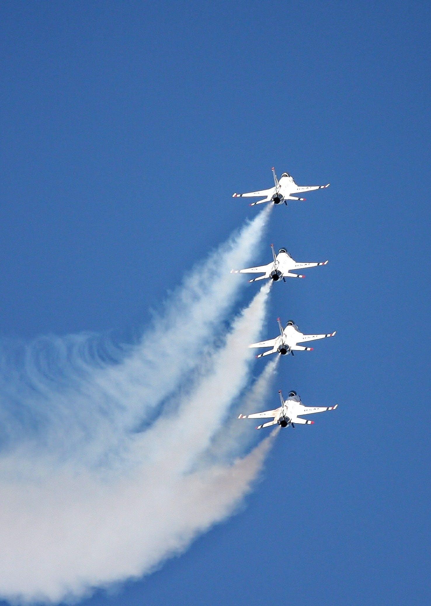 4 White Jet Flying on Sky at Daytime