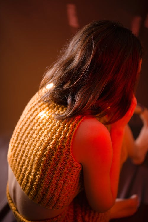 Woman Wearing Yellow Knitted Crop-top Shirt Sitting on Floor