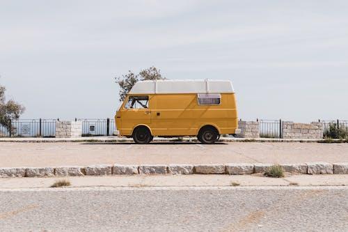 Yellow Van on Gray Concrete Road
