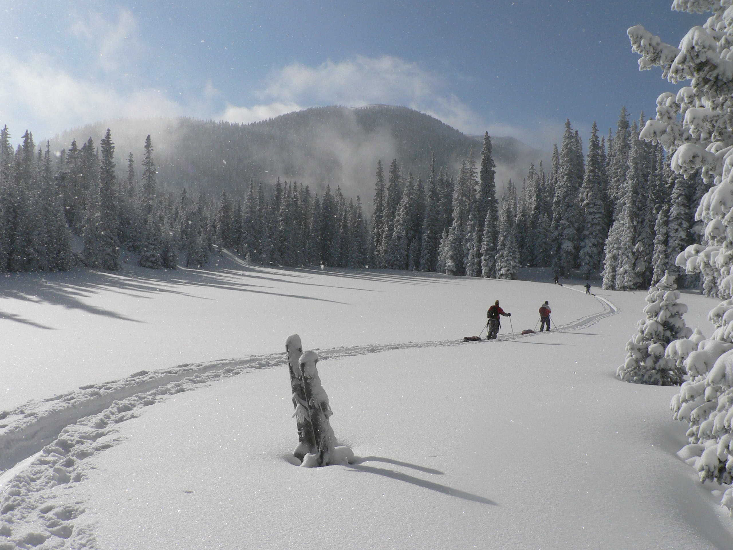 2 Person Walking on Snowfield during Daytime