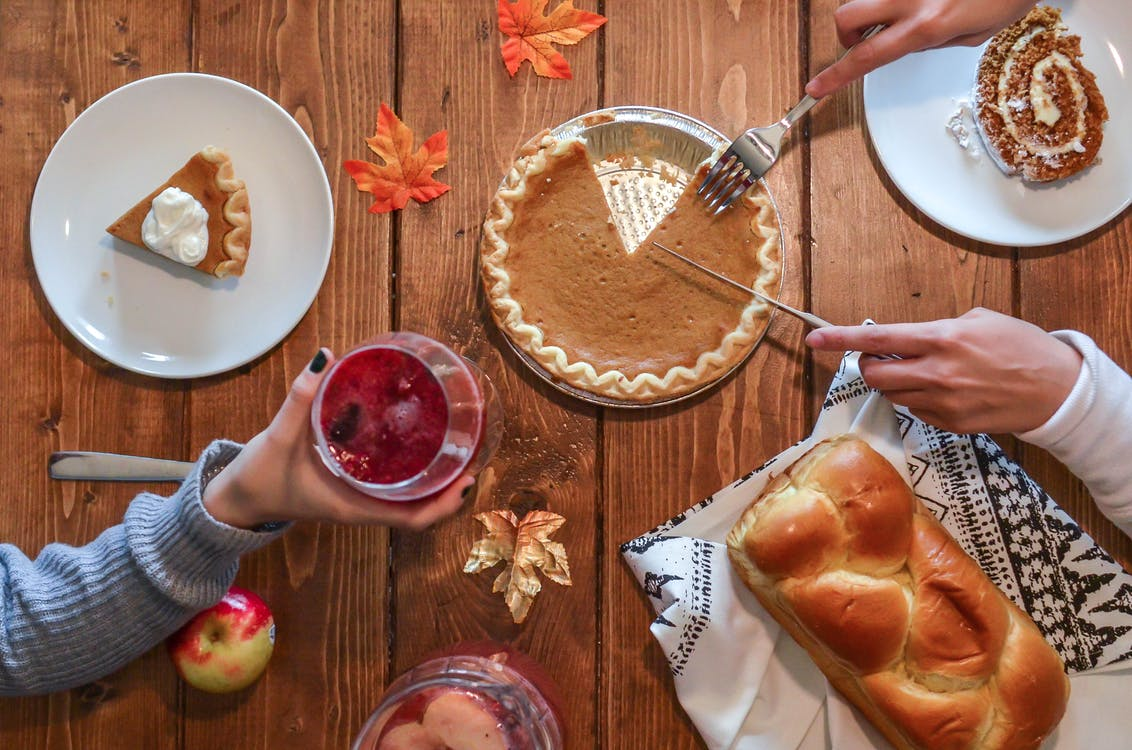 Person Slicing Pie on Aluminum Plate