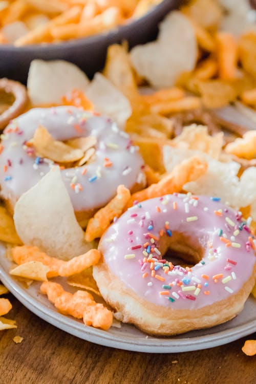 Glazed donuts with crisps ans chips