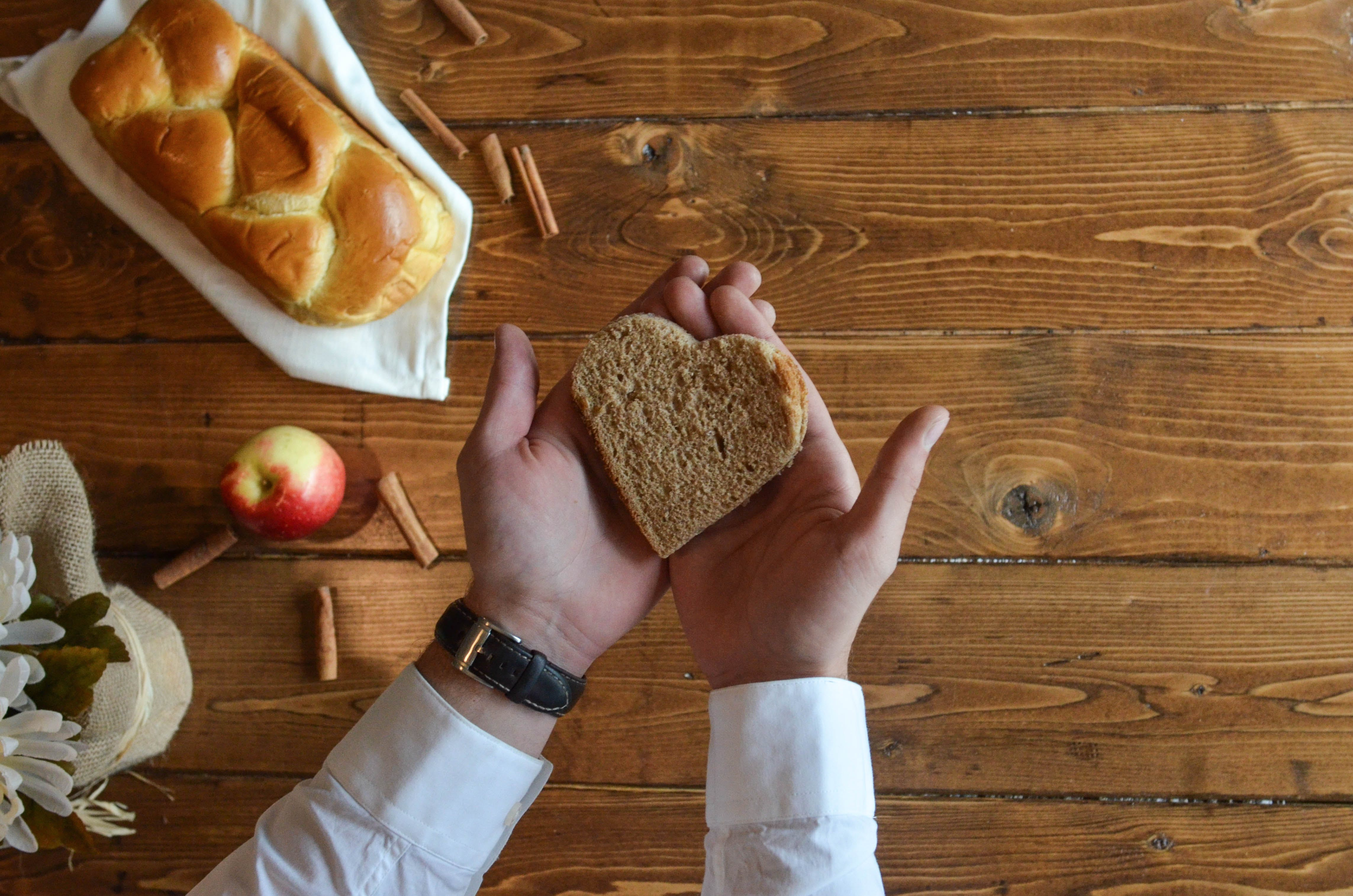 Person Holding Heart Shaped Bread