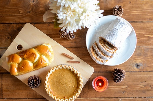Brown Pastry and Cupcake in Chopping Board
