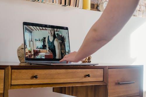 Person Holding Black Laptop Computer