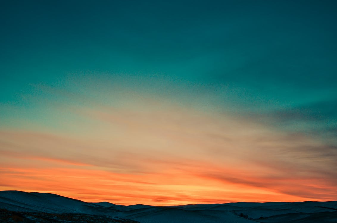 Sunset over Snow Covered Mountains