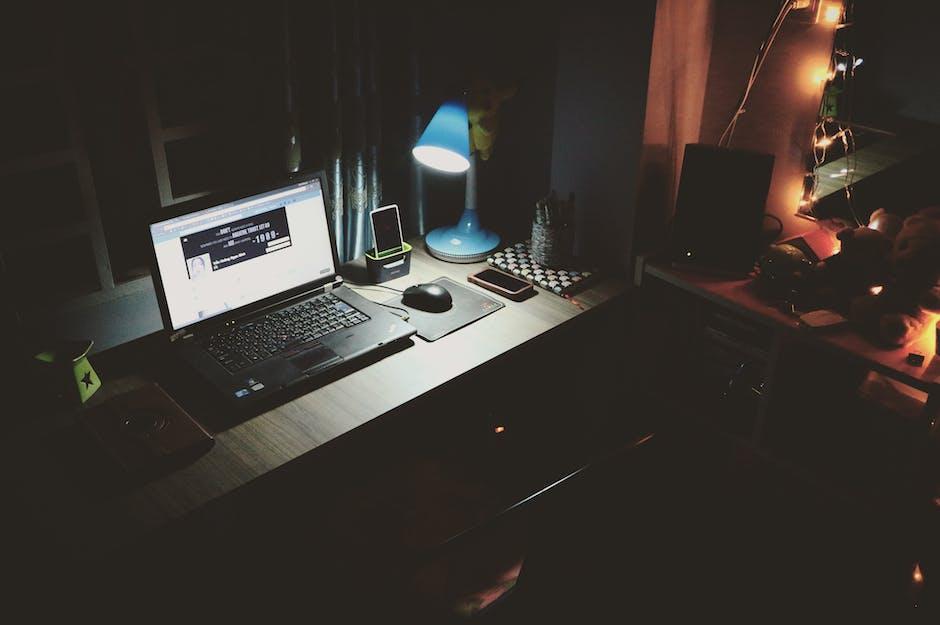 Black laptop beside black computer mouse inside room - Free room design website ...