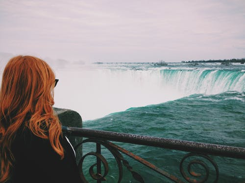Woman Standing Near of Niagara Falls