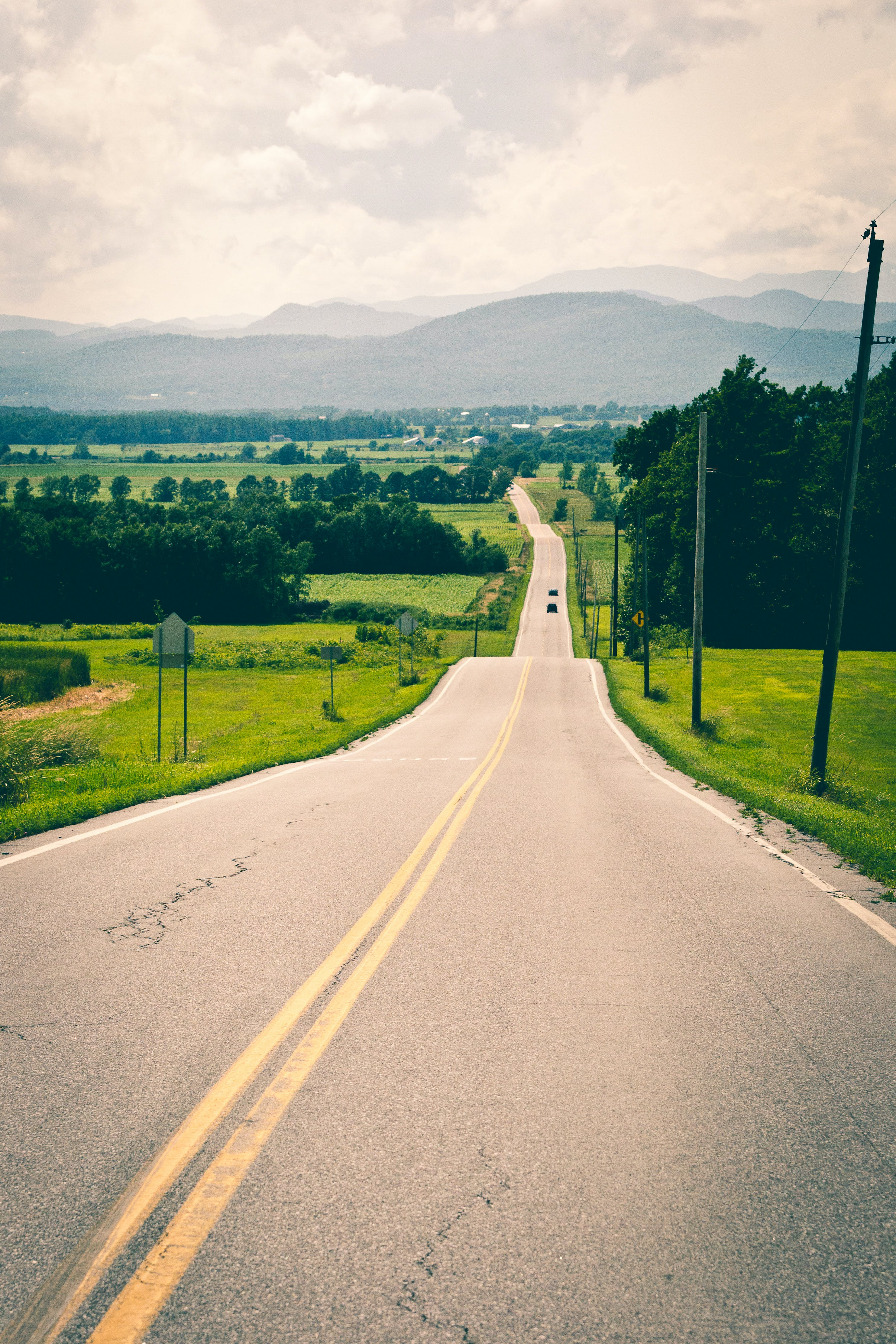 Long Road Under Cloudy Sky