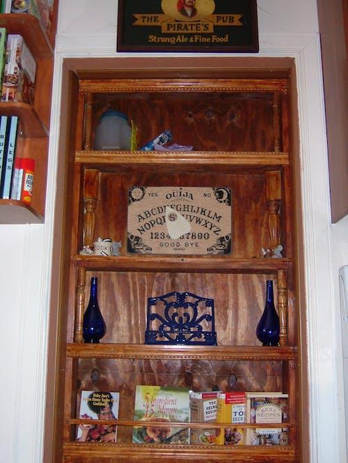 Free stock photo of bookcase, bookcase door, door
