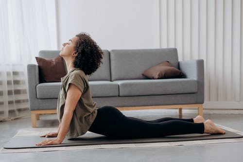 Side View Of Woman Doing Yoga