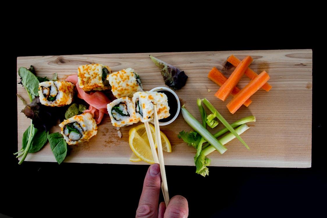Free stock photo of carrots, chop sticks, eating sushi