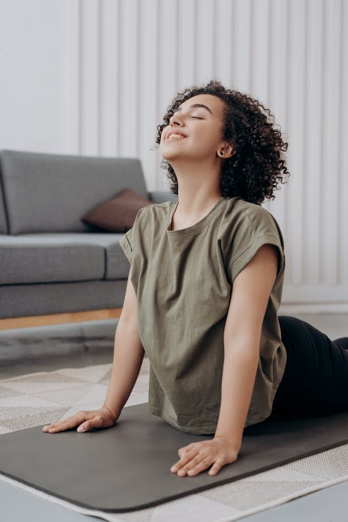Woman in Gray Crew Neck T-shirt Doing Yoga