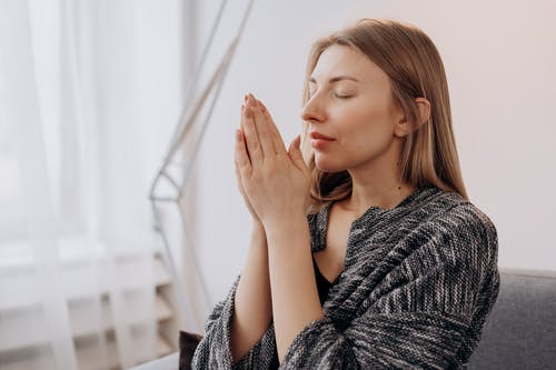 Woman Meditating In Close-up View