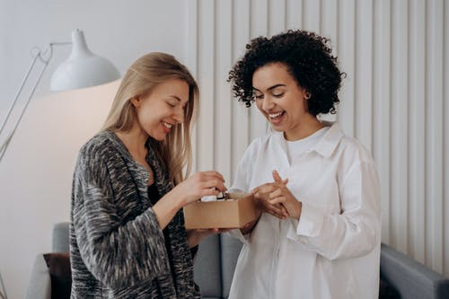 Two Women Enjoying A Box Of Beauty Products
