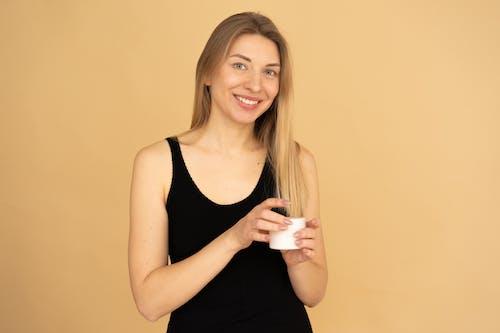 Woman Holding A Facial Cream