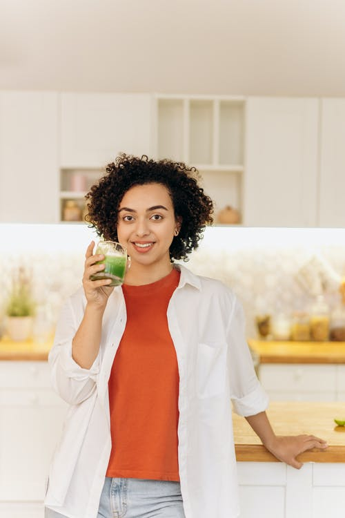 Woman in White Blazer Drinking Fresh Smoothie