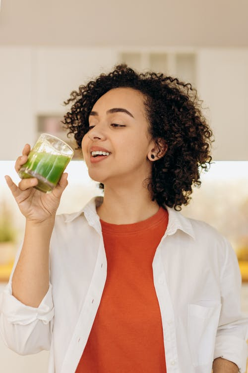 Woman Drinking A Glass Of Fresh Smoothie