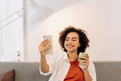 Woman Taking Selfie While Drinking A Fresh Smoothie