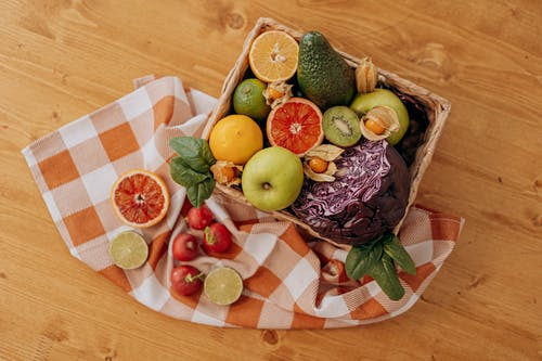 Assorted Fruits on Brown Woven Basket