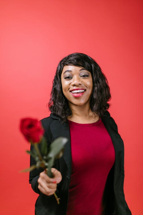 Woman in Black Cardigan Holding Red Rose