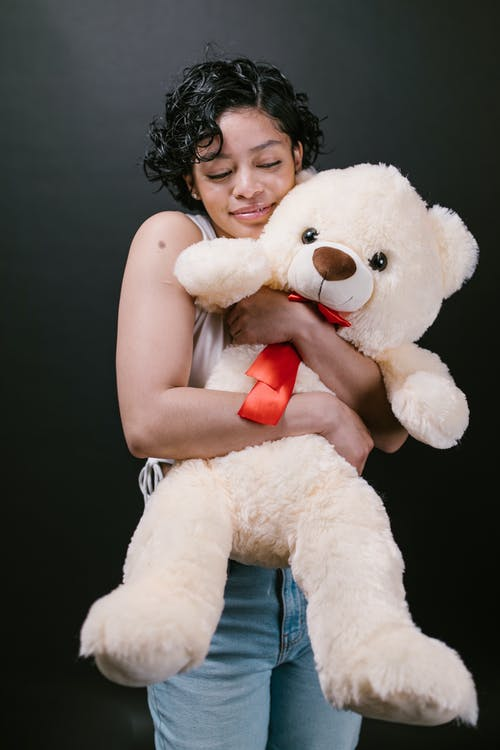 Woman Hugging White Bear Plush Toy