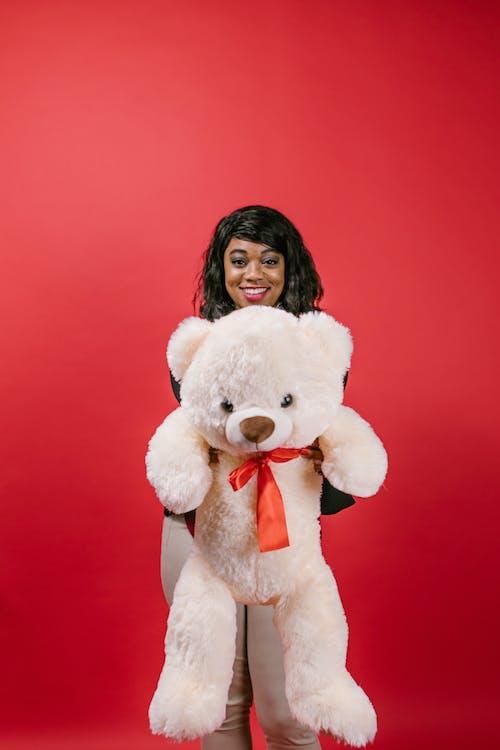 Woman Holding a Teddy Bear Stuffed Toy