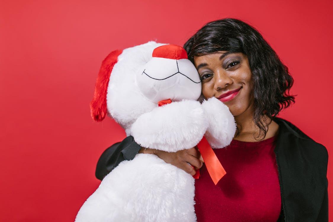 Woman Holding White Bear Plush Toy