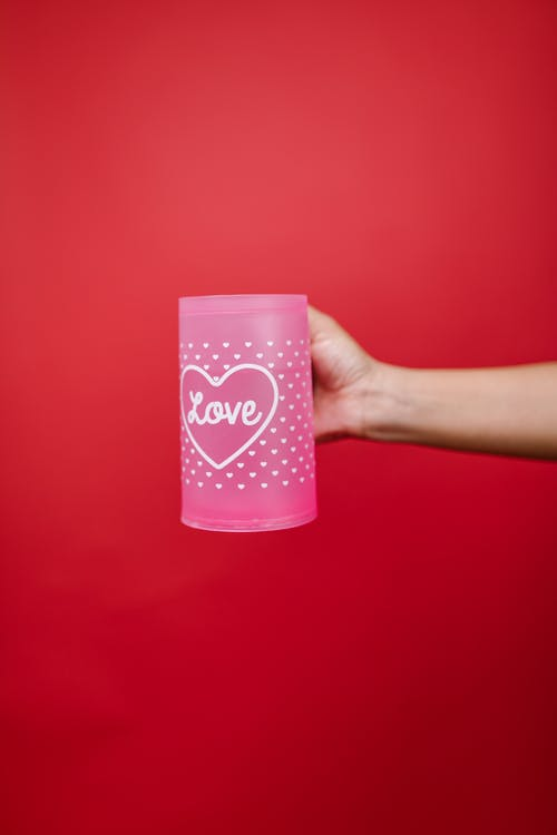 Person Holding Pink Mug