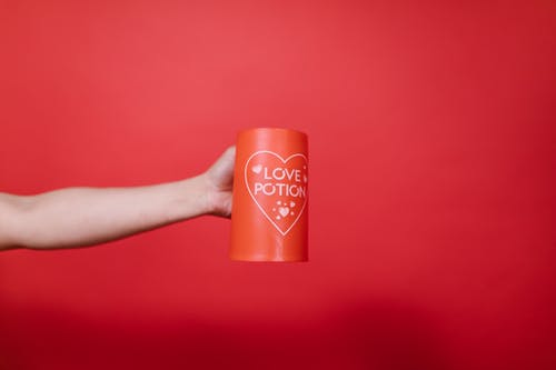 Person Holding Red Mug