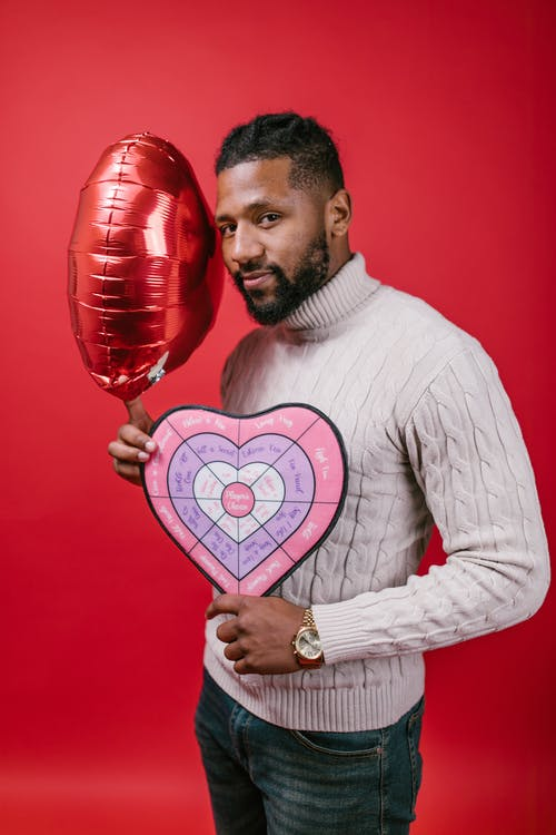 Man in White Long Sleeve Shirt Holding Valentine's Day Gifts