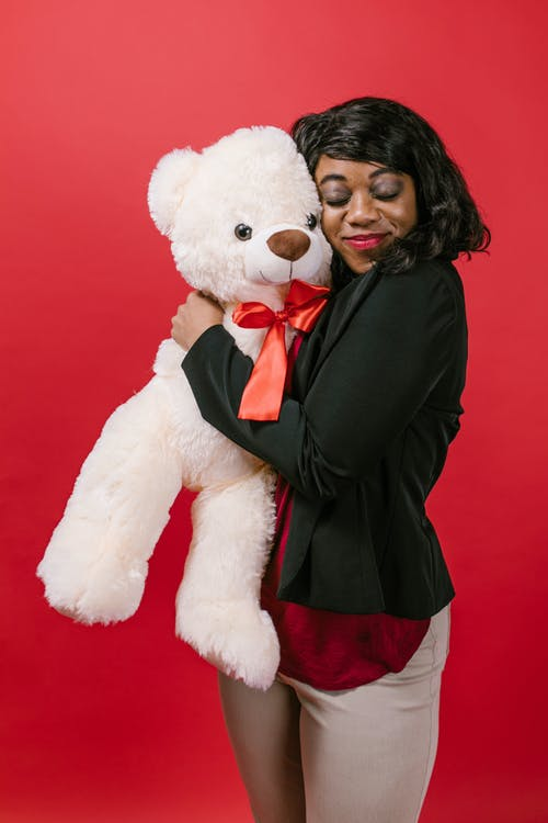Woman Hugging a Teddy Bear Tightly