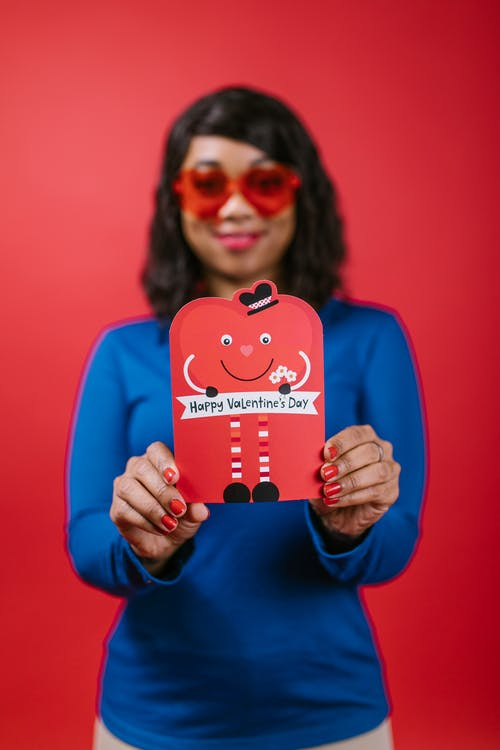 Woman Holding a Valentines Card