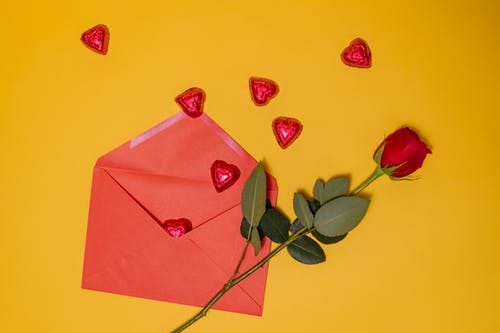 Red Envelope and Red Rose On Yellow Background