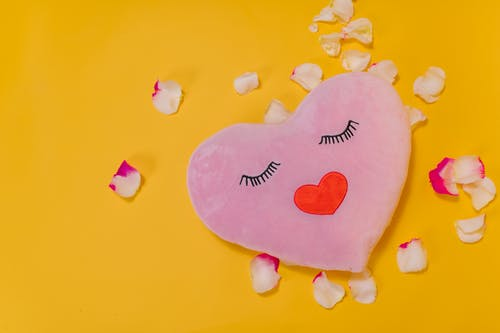 Heart Shaped Pillow on Yellow Background