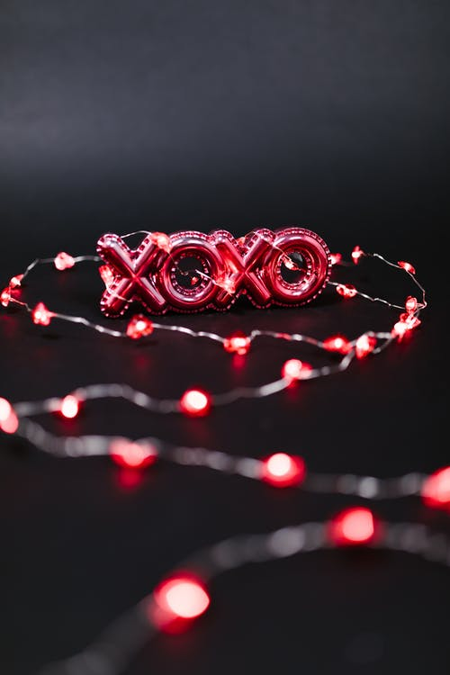 Red Xoxo and String Lights on Black Background