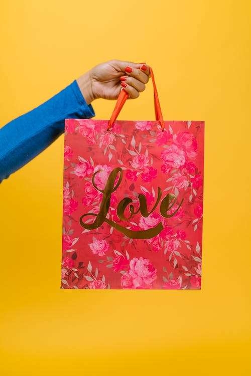 Person Holding Pink Floral Tote Bag