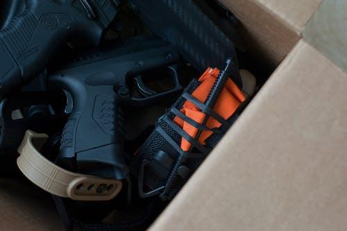 Black and Orange Semi Automatic Pistol