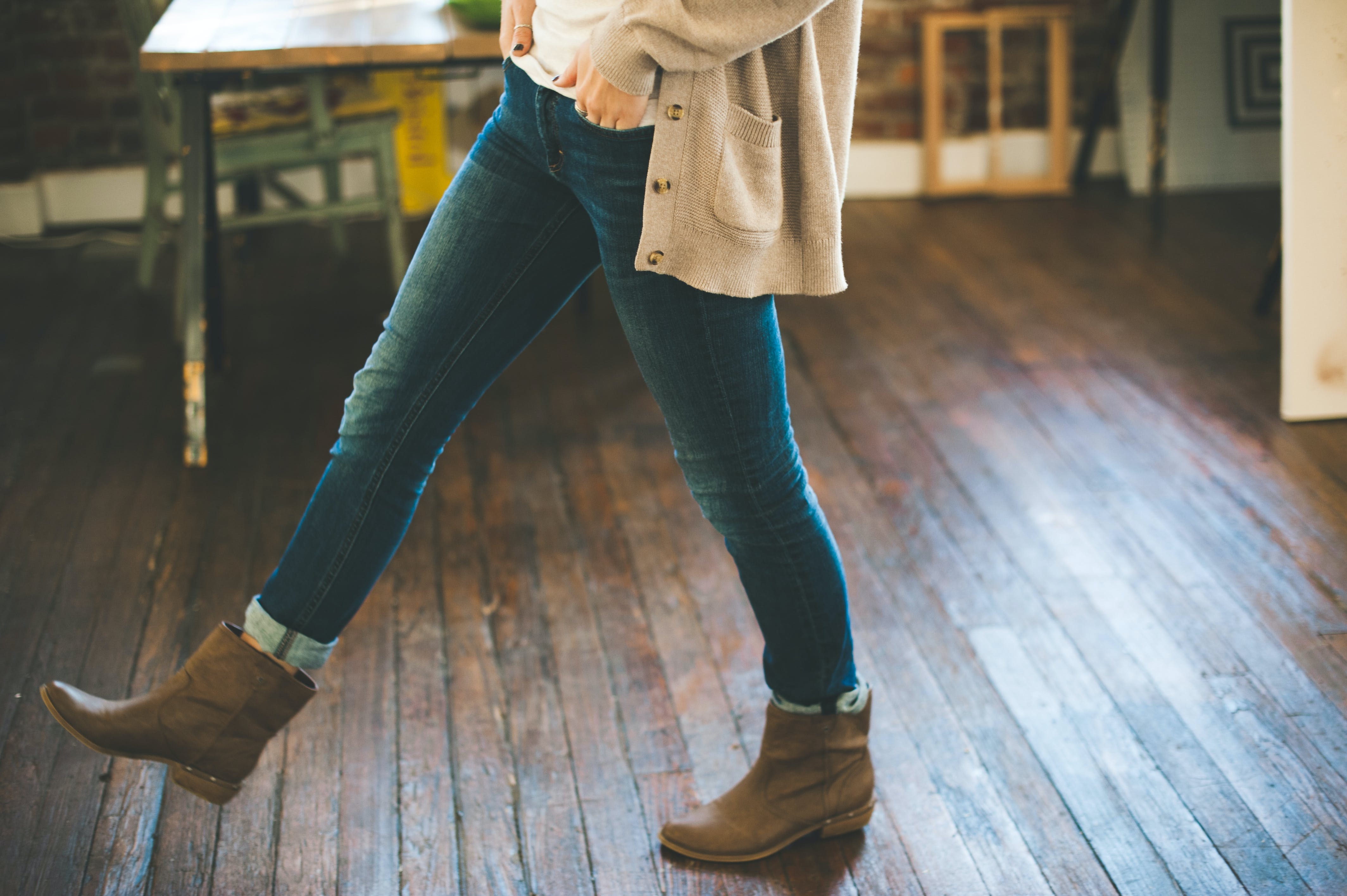 Woman Walking on Brown Parquet Floor