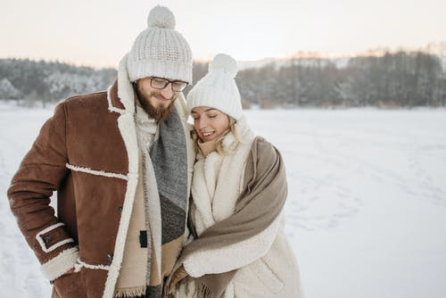 A Couple Walking on Snow